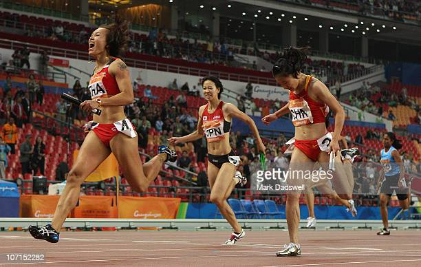 Nongnuch Sanrat of Thailand crosses the line to win gold in the Women's 4 x 100m Relay Final at Aoti Main Stadium during day fourteen of the 16th...
