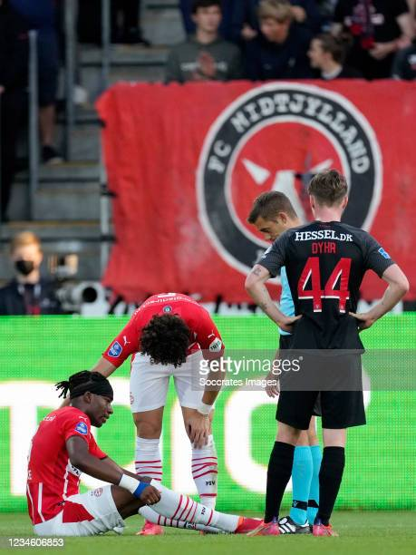Noni Madueke of PSV injury during the UEFA Champions League match between FC Midtjylland v PSV at the Arena Herning on August 10, 2021 in Herning...
