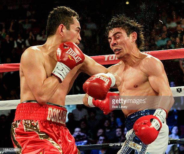 Nonito Donaire connects with a left hook to the head of Jorge Arce for a third round knockout at Toyota Center on December 15 2012 in Houston Texas
