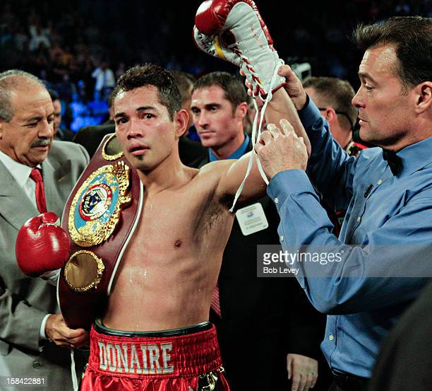 Nonito Donaire had his hand raised by referee Laurence Cole after knocking out Jorge Arce in the third round for the WBO World Super Bantamweight...