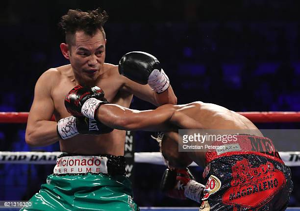 Nonito Donaire of the Philippines and Jessie Magdaleno exchange punches during their WBO junior featherweight championship fight at the Thomas Mack...