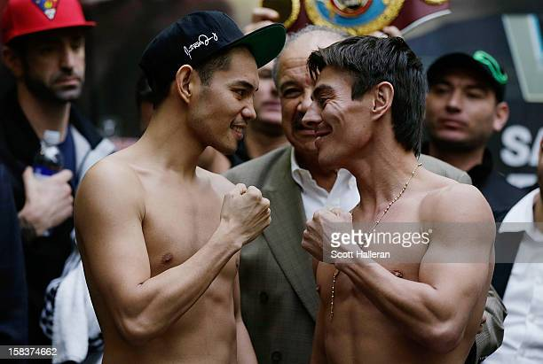 Nonito Donaire of the Philippines and Jorge Arce of Mexico pose on stage after their official weighin at the PlazAmericas Mall on December 14 2012 in...