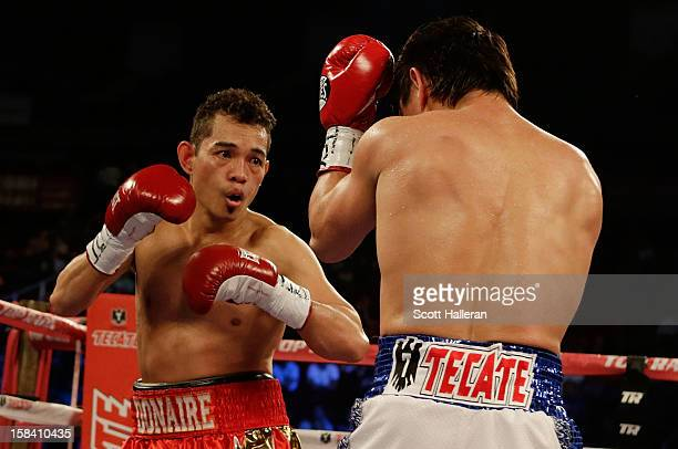 Nonito Donaire of the Philippines boxes with Jorge Arce of Mexico during their WBO World Super Bantamweight bout at the Toyota Center on December 15...