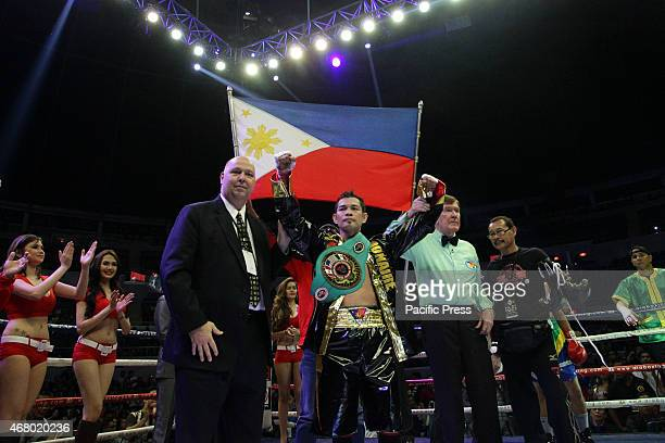 Nonito Donaire of the Philippines celebrates after defeating William Prado of Brazil in their WBC NABF Super Bantamweight Championship bout at the...