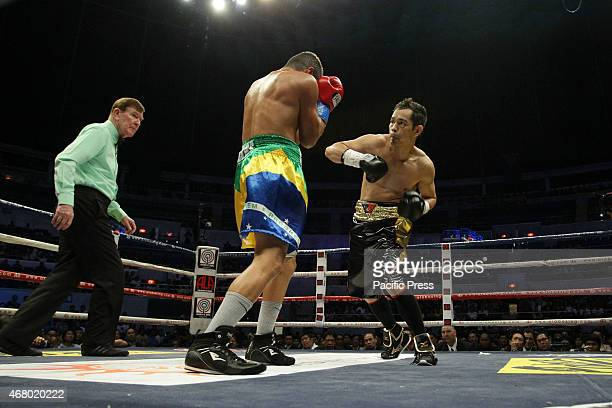Nonito Donaire of the Philippines punches William Prado of Brazil during their WBC NABF Super Bantamweight Championship bout at the Araneta Coliseum...