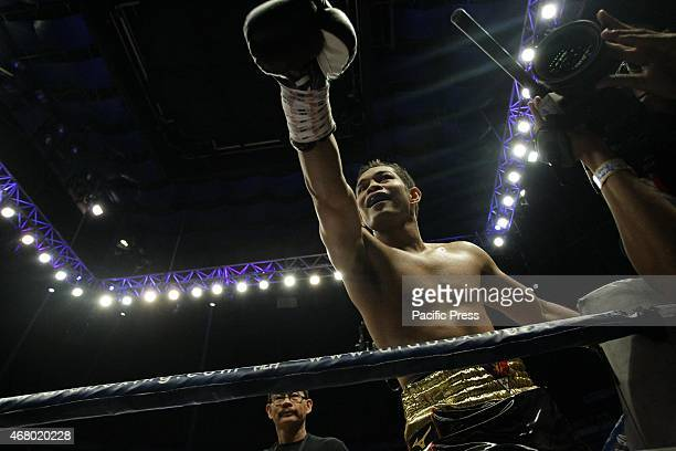Nonito Donaire of the Philippines rejoices after defeating William Prado of Brazil in their WBC NABF Super Bantamweight Championship bout at the...