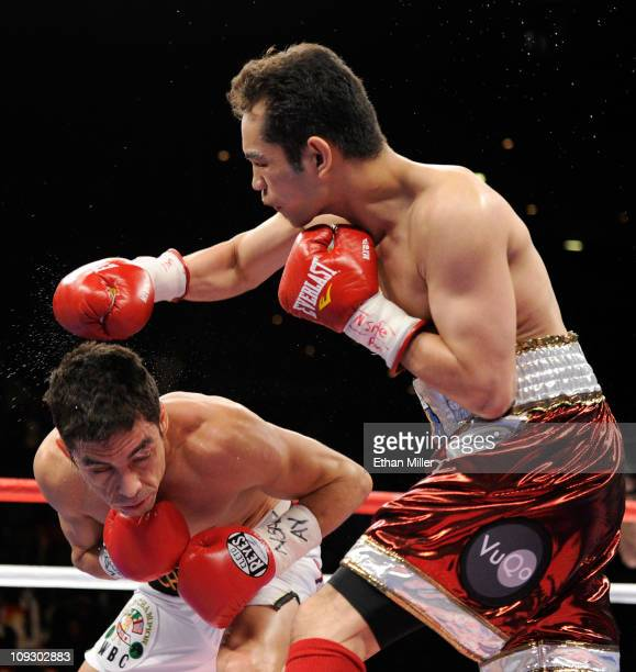Nonito Donaire of the Philippines throws a right at Fernando Montiel of Mexico in the second round of their WBC/WBO bantamweight championship bout at...