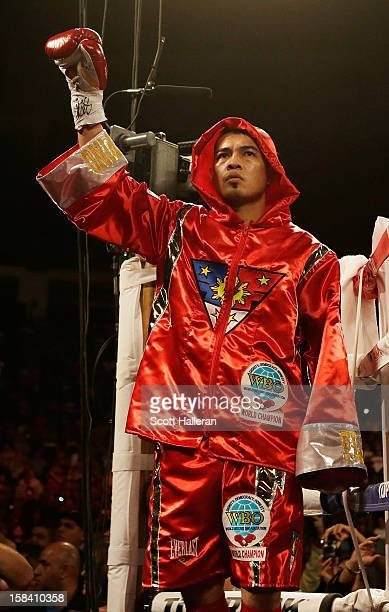 Nonito Donaire of the Philippines waves to the crowd before his WBO World Super Bantamweight bout with Jorge Arce of Mexico at the Toyota Center on...