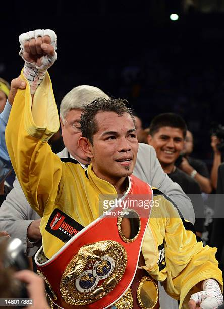 Nonito Donaire of The Phillipines celebrates a unanimous decision over Jeffery Mathebula of South Africa during the WBO IBF Super Bantamweight title...