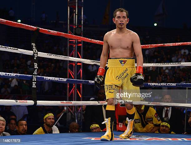 Nonito Donaire of The Phillipines waits in the corner after knocking down Jeffery Mathebula of South Africa during fourth round of the WBO IBF Super...