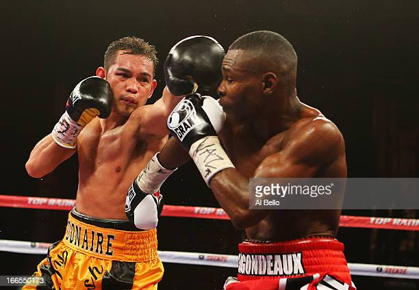 Nonito Donaire punches Guillermo Rigondeaux during their WBO/WBA junior featherweight title unification bout at Radio City Music Hall on April 13...