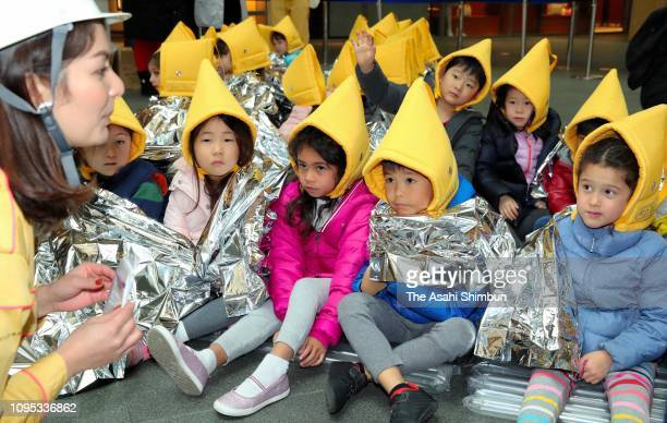 NonJapanese take part in an evacuation drill at the Roppongi Hills complex on January 17 2019 in Tokyo Japan During the past quartercentury the...