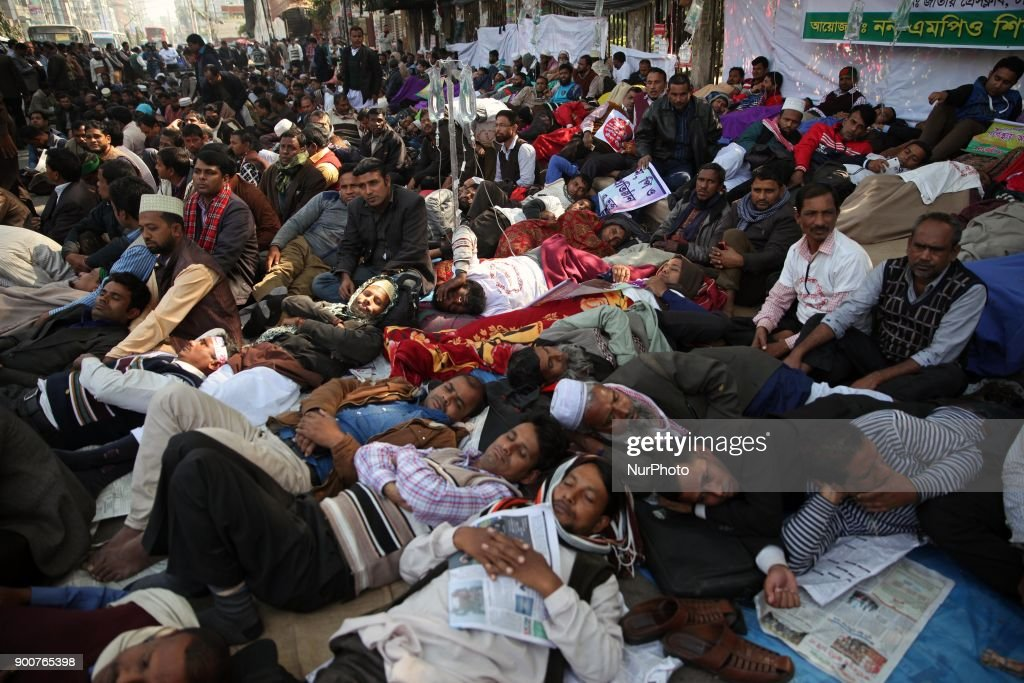 Non-MPO (monthly pay order) teachers from different non-government institutions, lay down in the street as they continue the four day of their fast unto death hunger strike program in front of the National Press Club in Dhaka, Bangladesh, 03 January 2018. Some hundred teachers went for hunger strike demanding their inclusion of the government-approved educational MPO facilities while more than 80,000 teachers from 5,242 non-MPO institutions are working without any pay, according to the leaders.