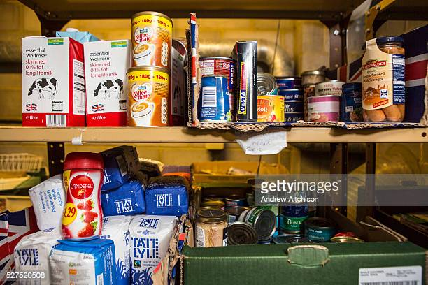 Nonperishable food donated by members of the public on the selves at the Trussell Trust's Kingston Foodbank Kingston United Kingdom Every day people...
