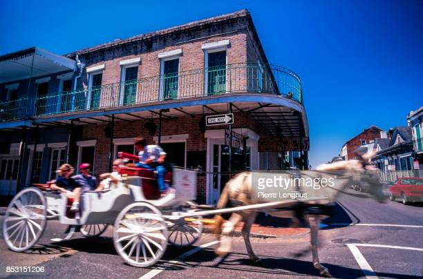 Non-recognizable people riding a Horse-Drawn Carriage with motion blur effect, French Quarter, New Orleans, Louisiana, USA