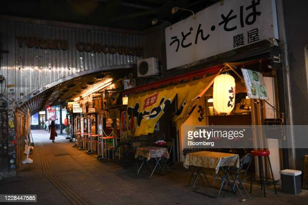 Noodle shop and izakaya restaurants sit under railway tracks in Tokyo, Japan, on Thursday, Sept. 3, 2020. In Tokyo, the spaces beneath elevated...