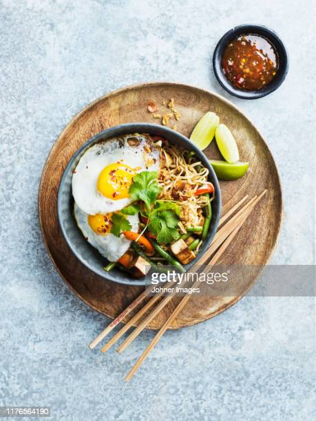noodles in bowl - noodles stock pictures, royalty-free photos & images