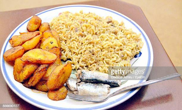 noodles served with fish and potato - nigerian food stock pictures, royalty-free photos & images