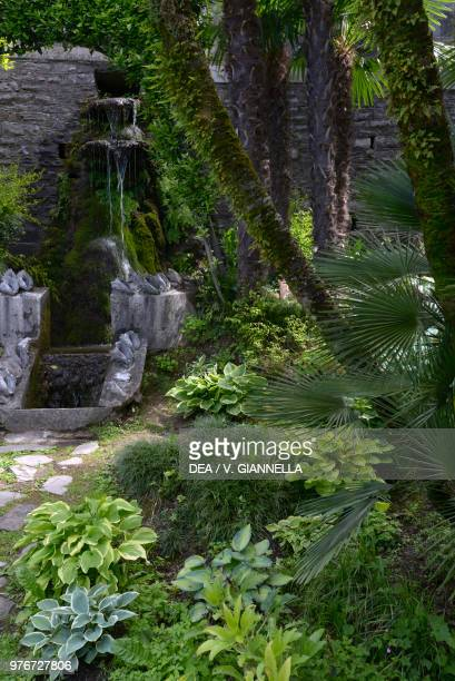 A nook of the garden of Villa Monastero with a waterfall fountain Varenna Lombardy Italy 19th20th century