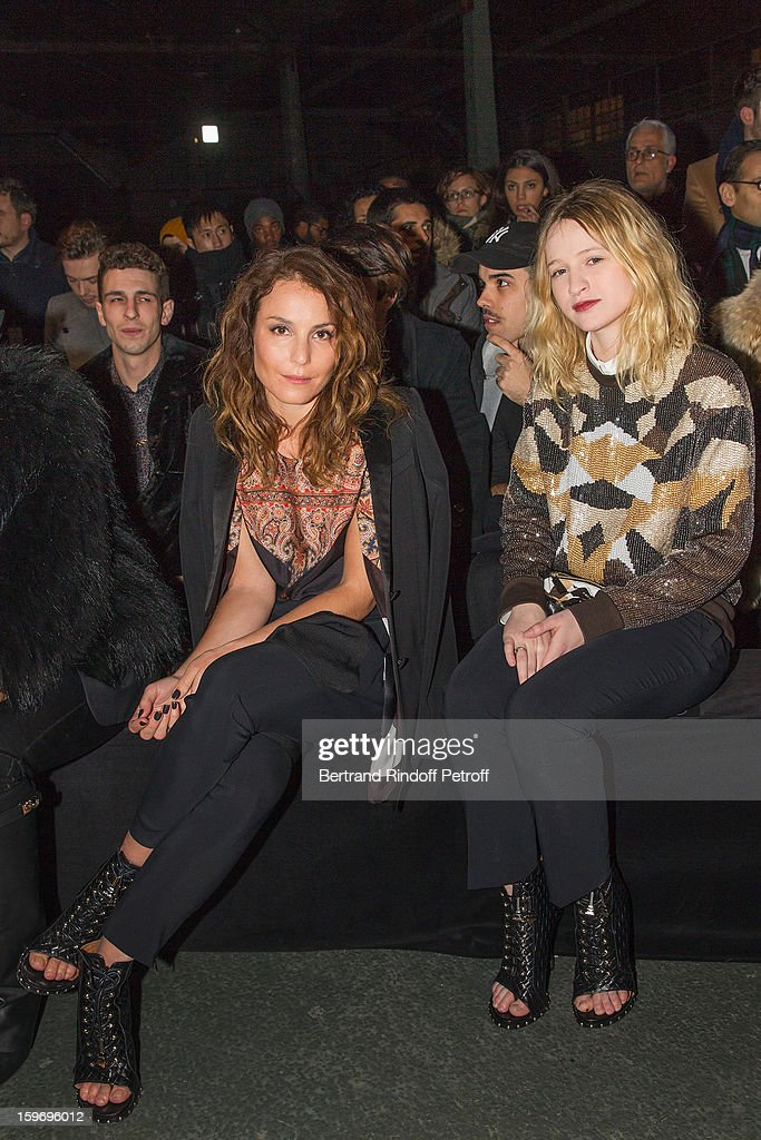 Noomi Rapace (L) and Christa Theret attend the Givenchy Men Autumn / Winter 2013 show as part of Paris Fashion Week on January 18, 2013 in Paris, France.