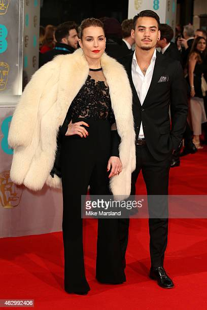 Noomi Rapace and guest attend the EE British Academy Film Awards at The Royal Opera House on February 8, 2015 in London, England.