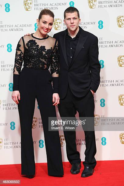 Noomi Rapace and Jesse Eisenberg pose in the winners room at the EE British Academy Film Awards at The Royal Opera House on February 8 2015 in London...