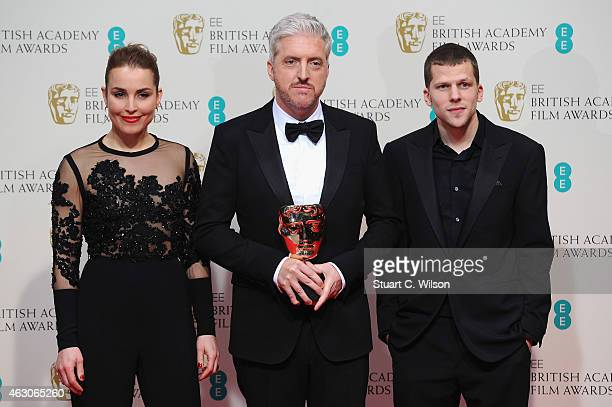 Noomi Rapace and Jesse Eisenberg with Anthony McCarten in the winners room at the EE British Academy Film Awards at The Royal Opera House on February...