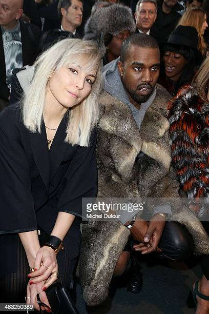 Noomi Rapace and Kanye West attend the Givenchy Menswear Fall/Winter 20142015 Show as part of Paris Fashion Week on January 17 2014 in Paris France
