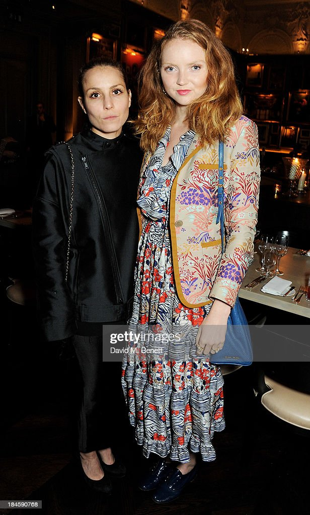 Noomi Rapace (L) and Lily Cole attend the London EDITION and NOWNESS dinner to celebrate ON COLLABORATION on October 14, 2013 in London, England.