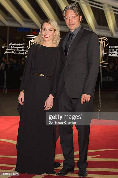 Noomi Rapace and Mads Mikkelsen attend the 'Waltz With Monica' Premiere At 13th Marrakech International Film Festival on December 4 2013 in Marrakech...