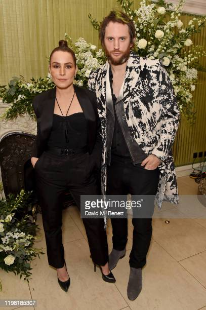 Noomi Rapace and Marc JacquesBurton attend the British Vogue and Tiffany Co Fashion and Film Party at Annabel's on February 2 2020 in London England