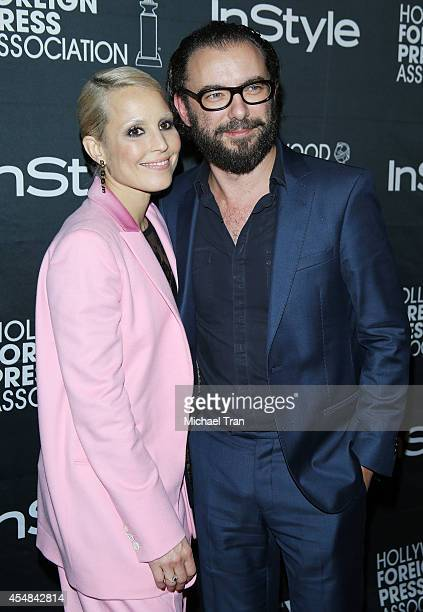 Noomi Rapace and Michael R Roskam arrive at the HFPA InStyle's 2014 TIFF Celebration held during the 2014 Toronto International Film Festival on...