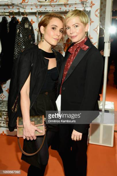 Noomi Rapace and Michelle Williams attend the Louis Vuitton X Grace Coddington Event on October 25 2018 in New York City