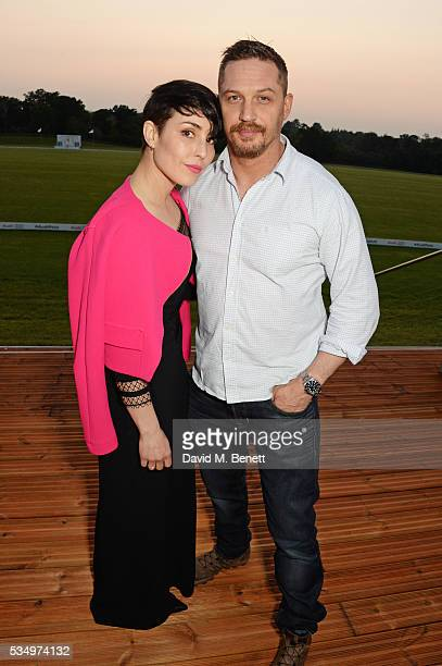Noomi Rapace and Tom Hardy attend day one of the Audi Polo Challenge at Coworth Park on May 28 2016 in London England