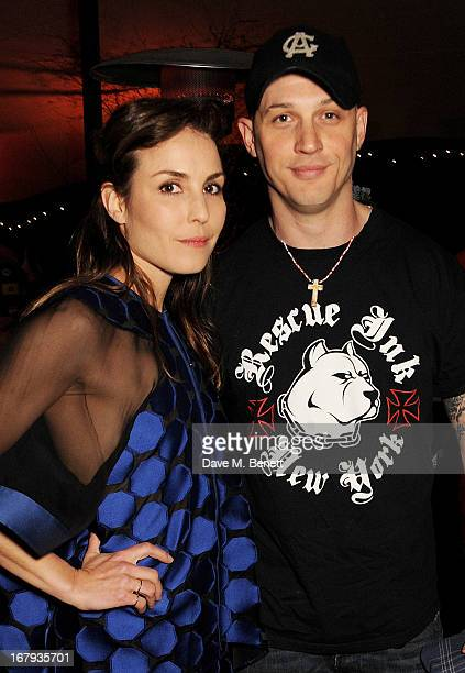 Noomi Rapace and Tom Hardy attend Gabrielle's Gala 2013 supported by Lorraine Schwartz at Battersea Power Station on May 2 2013 in London England