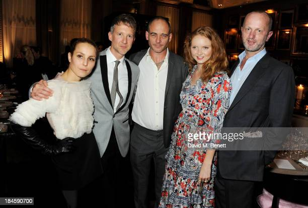 Noomi Rapace Jefferson Hack Dinos Chapman Lily Cole and Johnnie Shand Kydd attend the London EDITION and NOWNESS dinner to celebrate ON COLLABORATION...