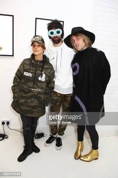Noomi Rapace Serge Pizzorno and Noel Fielding attend a private view of Daft Apeth by Serge Pizzorno of Kasabian at No Ho Showrooms on October 18 2018...