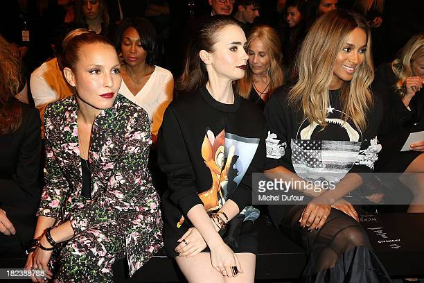 Noomie Rapace Lily Collins and Ciara Princess Harris attend the Givenchy show as part of the Paris Fashion Week Womenswear Spring/Summer 2014 on...