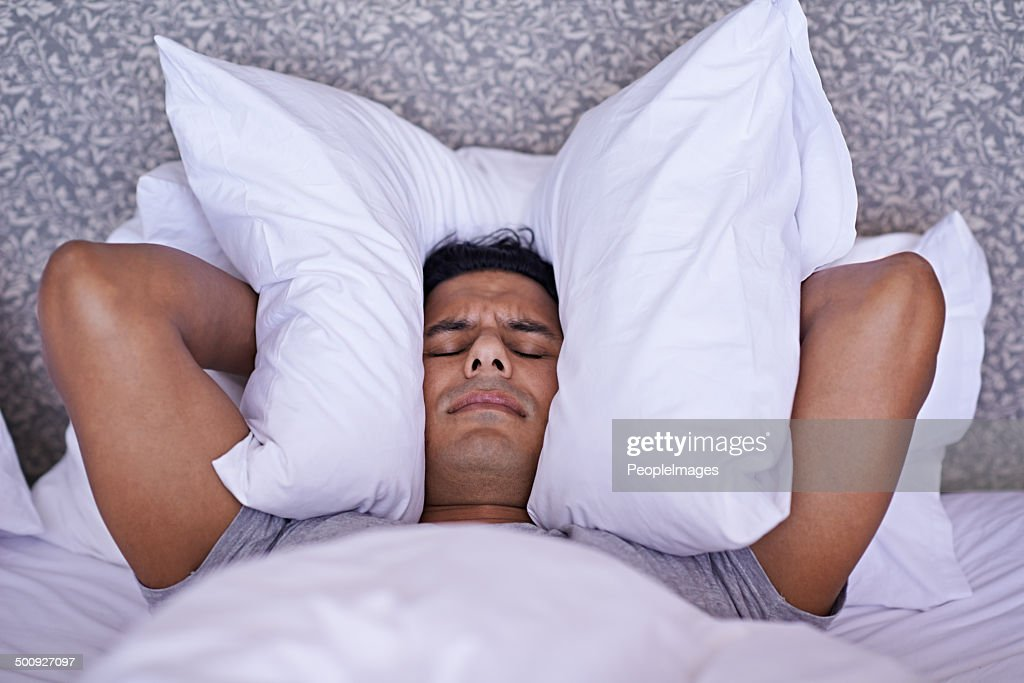 No-one can sleep with all this noise! : Stock Photo