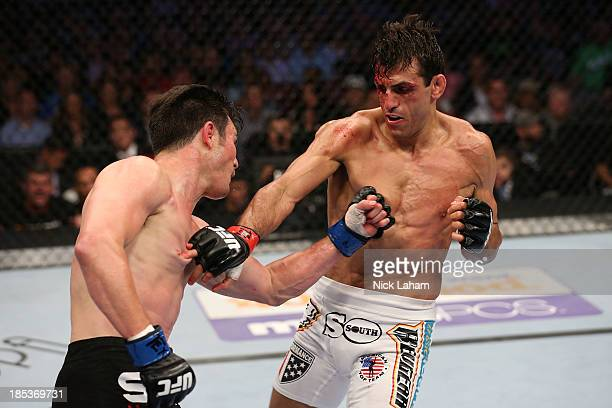 KJ Noons and George Sotiropoulos exchange punches in their UFC lightweight bout at the Toyota Center on October 19 2013 in Houston Texas