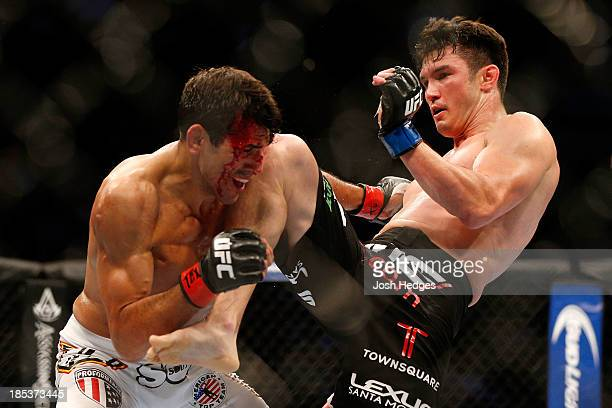 KJ Noons lands a knee to George Sotiropoulos in their UFC lightweight bout at the Toyota Center on October 19 2013 in Houston Texas