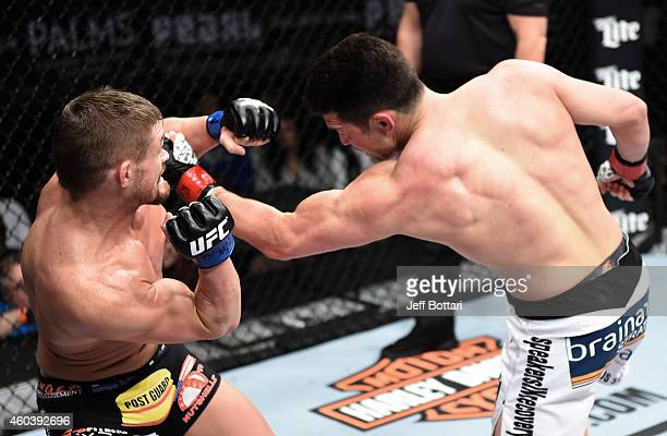 KJ Noons punches Daron Cruickshank in their lightweight fight during The Ultimate Fighter Finale event inside the Pearl concert theater at the Palms...