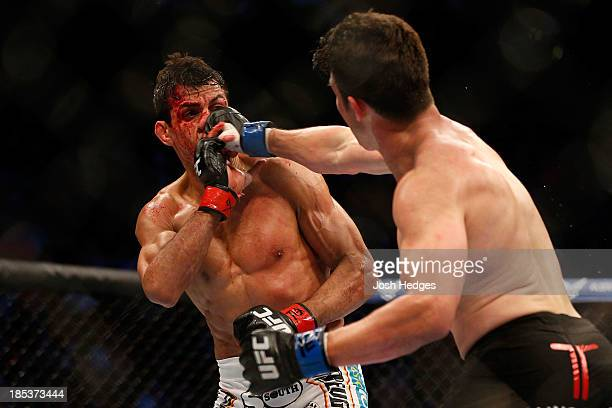 KJ Noons punches George Sotiropoulos in their UFC lightweight bout at the Toyota Center on October 19 2013 in Houston Texas