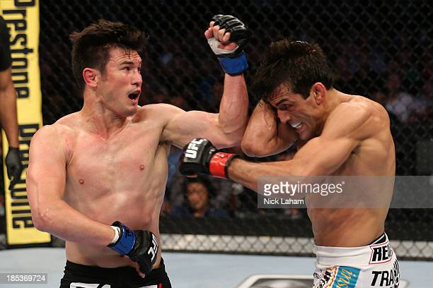 KJ Noons throws an elbow at George Sotiropoulos in their UFC lightweight bout at the Toyota Center on October 19 2013 in Houston Texas