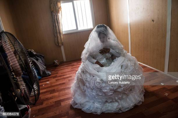 Noor age unknown awaits her groom in a beauty salon in the Zaatari refugee camp in Jordan August 25 2014 While marriage under the age of eighteen was...