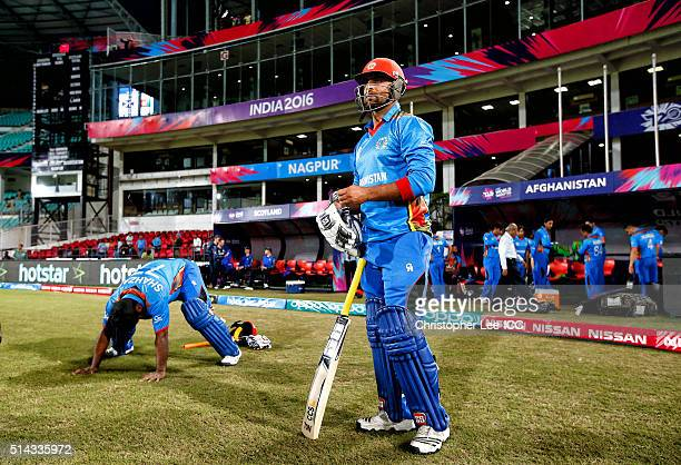 Noor Ali Zadran of Afghanistan Mohammad Shahzad of Afghanistan prepare to open the batting during the ICC Twenty20 World Cup Group B match between...