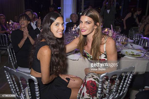 Noor Fares and Bianca Brandolini D'adda attend the amfAR dinner at the Pavillon LeDoyen during the Paris Fashion Week Haute Couture on July 5 2015 in...
