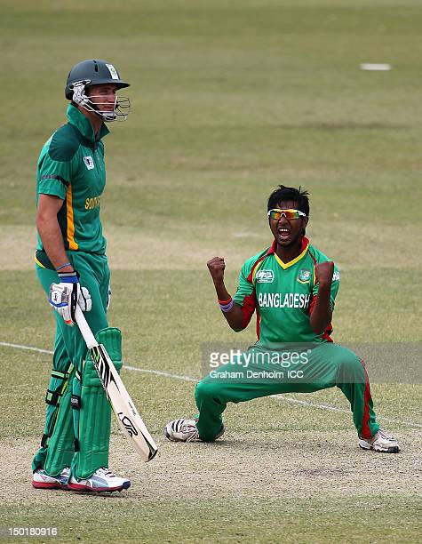 Noor Hossain of Bangladesh celebrates the wicket of Quinton de Kock of South Africa as South African team mate Theunis de Bruyn looks dejected during...