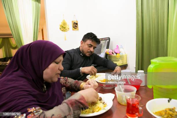 Noor Jahan Shukor eats with her son Ahmed on January 12 2019 in Chicago Illinois The Shukor family arrived in Chicago in 2014 from Malaysia Mohammad...
