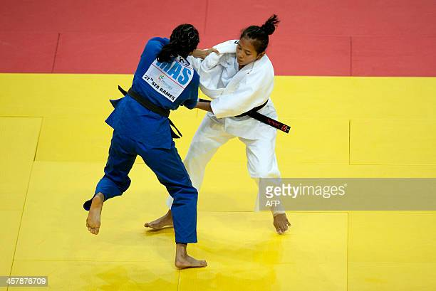 Noor maizura Zainon of Malaysia fights with Ismayasari of Indonesia during the women's Judo 4852Kg bronze medal bout during the 27th Southeast Asian...